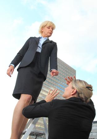criticizes: A Female Bos criticizes worker Stock Photo