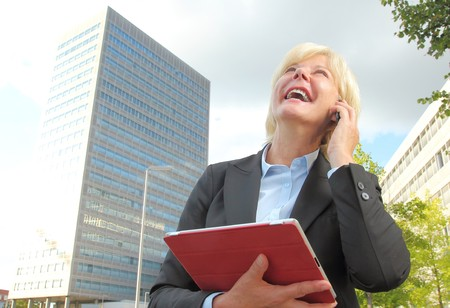 looking after: A Happy Businesswoman with tablet and mobile