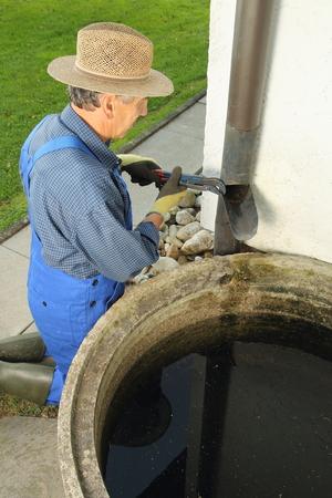 A man collection rain water photo