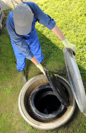 A Gardener obove underground rainwater cistern photo