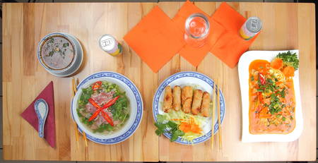 A Table with different asian meals photo