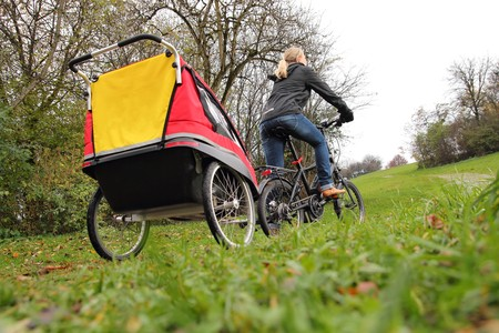 A Mother with child bike trailer photo