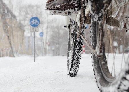 Riding a bicycle in Winter over snow