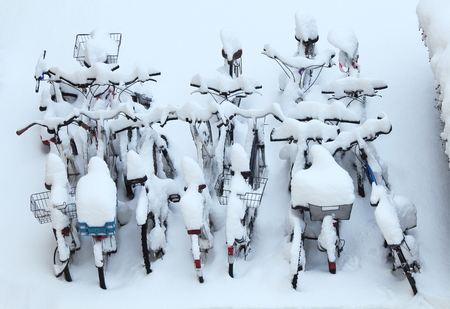 parked bicycles: Many Bicycles winter snow covered Stock Photo