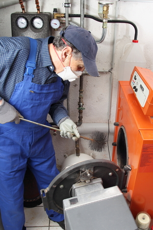 dust mask: A specialist doing Boiler cleaning