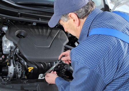 coolant: A Man checking Frost protection of  coolant in car