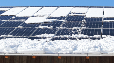solar panel roof: Snow reducing output of  photovoltaic panels on a roof
