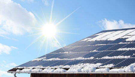 solar roof: A Snow coverred photovoltaic system Stock Photo