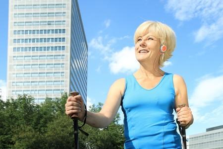 nordic walking: A Elderly woman doing nordic walking outdoor Stock Photo