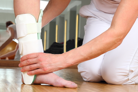 orthopedist: A Orthopedist  with Patient and Ankle orthosis