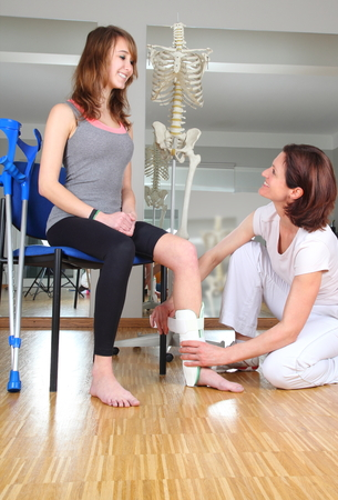 A Physiotherapist and patient with knuckle injury