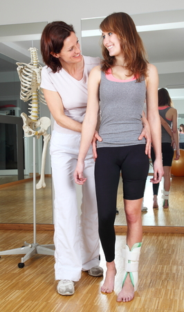 A Physiotherapist and patient with foot injury