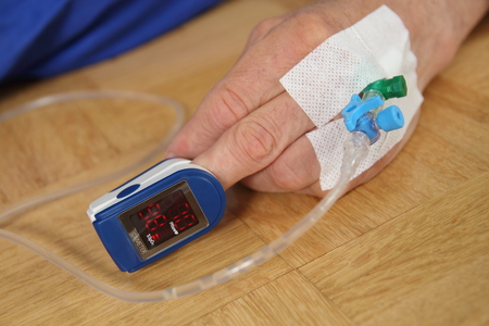 accident rate: A Hand of a patient with Pulse oximetry