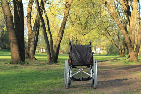 wheelchair access: A Empty wheelchair standing in a park Stock Photo