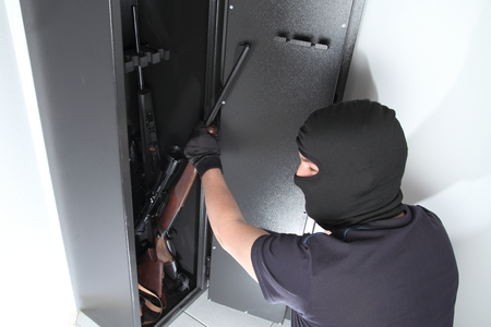 cupboard: A Burglary and theft on Guns in a gun safe Stock Photo