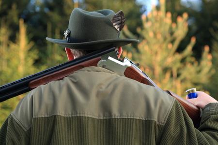shot gun: A Hunter shouldering his shot gun