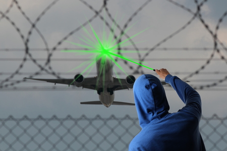 plane landing: A Starting Airplane blinded with a Laserpointer Stock Photo