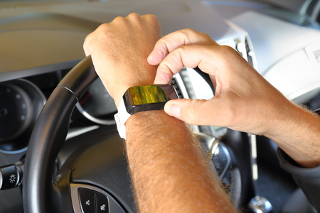 automatically: Man in car with connected smartphone