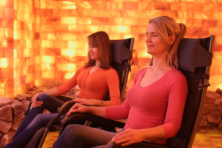 Two women relaxing in a salt cave at a Halotherapy