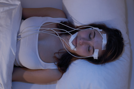lab: A Woman asleep measering brainwaves eg in a Sleep Lab Stock Photo