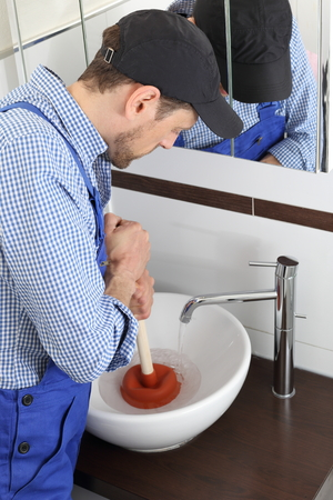 sucker: A Plumber cleaning a drain with a Suction rubber sucker cup