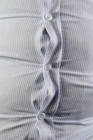 A Fat man with folding shirt