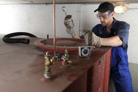 tightness: Man doing Oil tank Tank cleaning