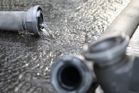 fire hoses: Some Fire hoses on a asphalt street