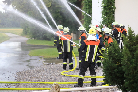 Groupt of Firefighters firemen extinguishing fire in operation