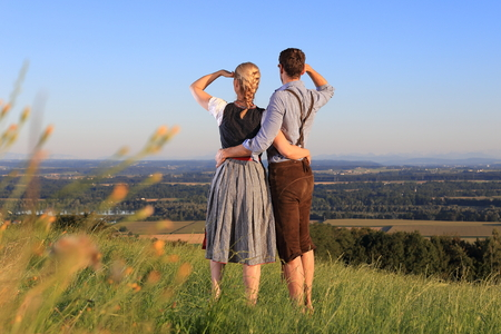lookout: A German Couple in Bavarian Costume on the lookout in nature Stock Photo