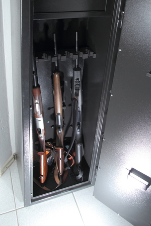 A Gun cabinet safe long guns hunting rifles.JPG Stock Photo - 65407123