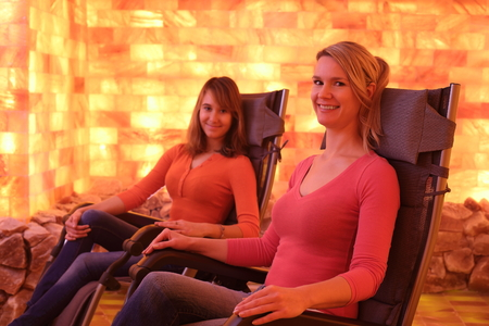 catarrh: Two happy women relaxing in a holotherapy salt room