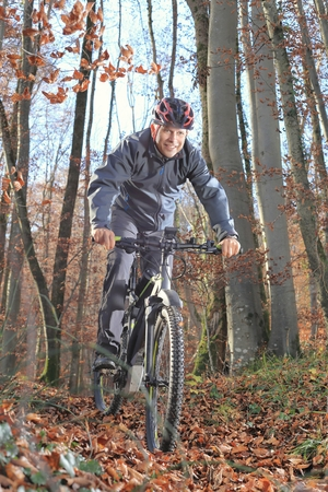 A Senior on Mountainbike in forest