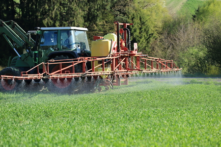 A Tractor spraying agriculture pesticide