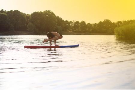 SUP Yoga at a stand up paddling board photo