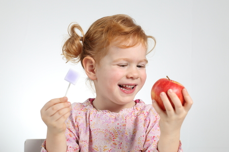 A Child preferring healtthy food and no sweets Standard-Bild - 92568940