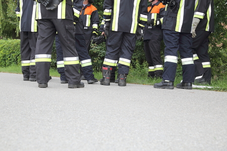 A Team of Firefighters discussing pausing just Feet Imagens