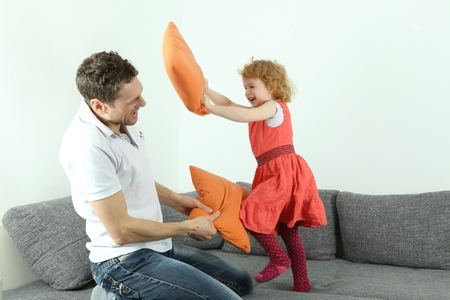 A Pillow fight dad with child or father with daughter