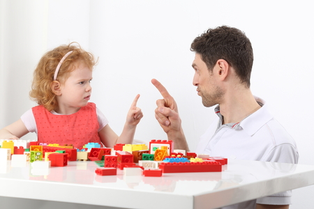 A Father and child daughter defiance phase discussion Stockfoto