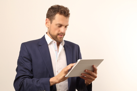 A Modern business man with tablet PC Imagens