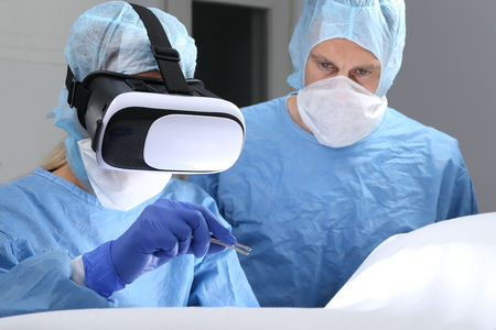 Two Doctors in Operating room surgery with virtual reality Standard-Bild - 119226601