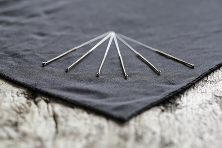 A Closeup of various Acupuncture needles with depth of field