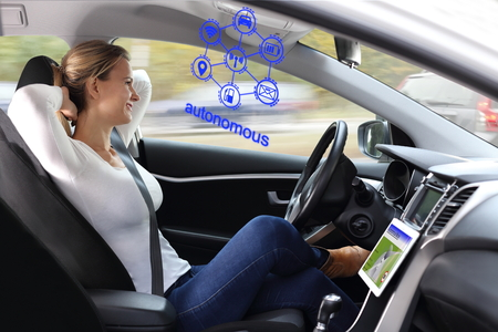 A Woman enjoys autonomous driving