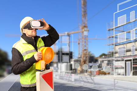 A Worker on Construction site with VR glasses smart city Standard-Bild - 119226062