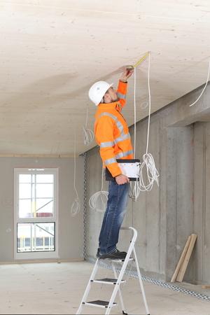 A Construction expert appraiser checking a new construction