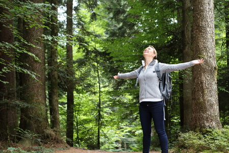 A Woman happy in nature forest Standard-Bild - 121545882