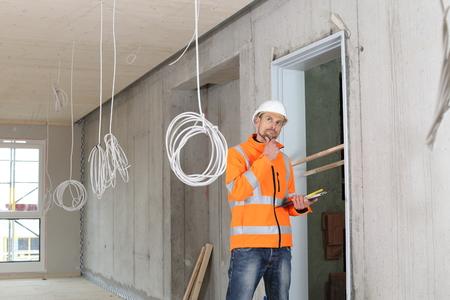 A Critical construction expert appraiser checking a constructin site