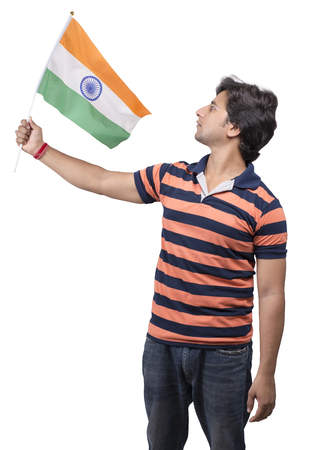indian male model holding indian flag in his hand