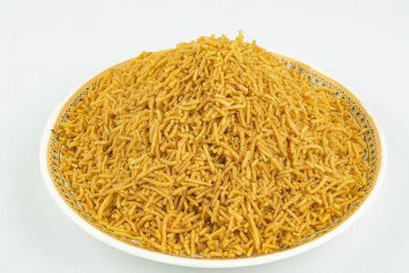 traditional indian spicy and crunchy aloo bhujiya namkeen Stock Photo