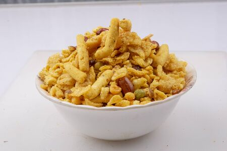 indian khatta meetha mixture namkeen in white bowl